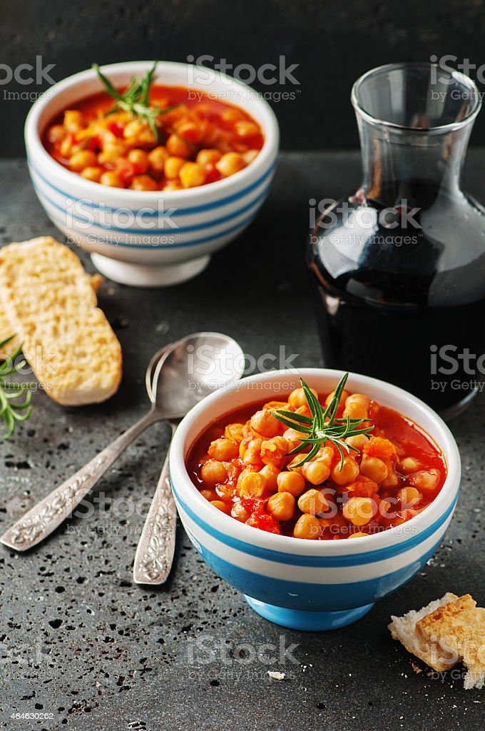 chick-pea with tomato, carrot and rosemary stock photo