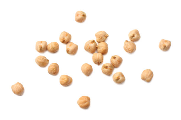 chickpeas isolated on white background. top view chickpeas isolated on white background. top view chick pea stock pictures, royalty-free photos & images