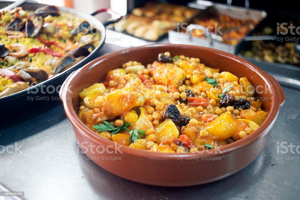 Chickpeas with cod. Mediterranean style cuisine. stock photo