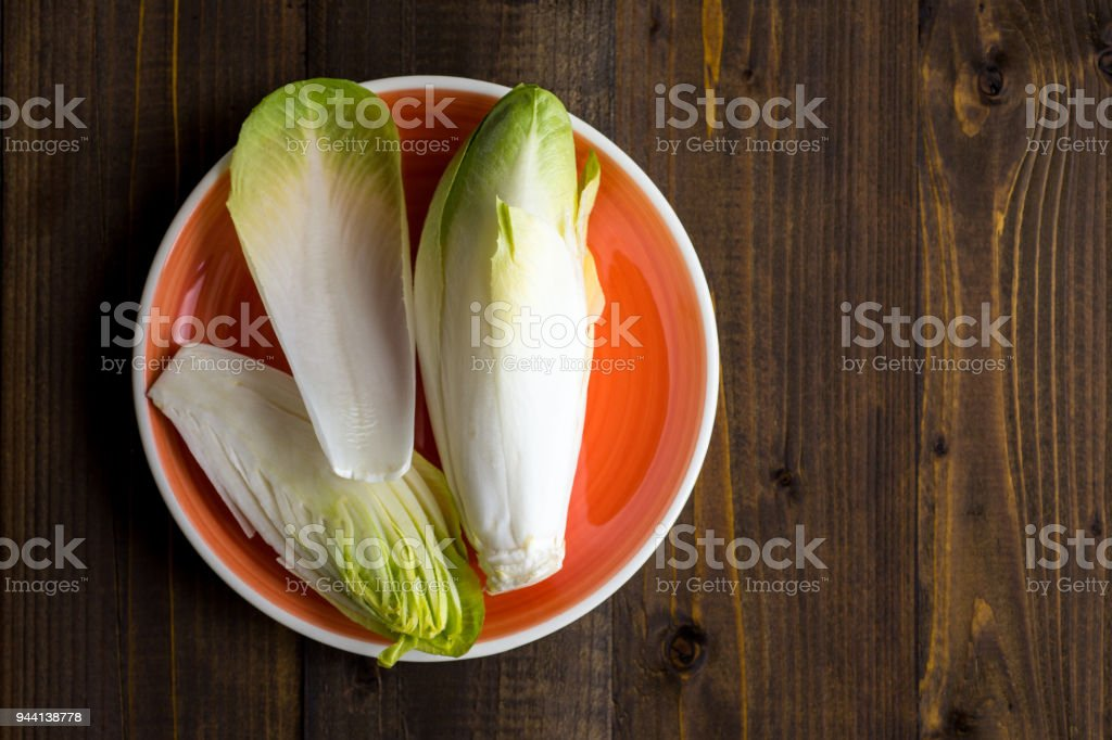 Chicory Fresh Salad. Raw Witloof Organic Healthy Food. stock photo