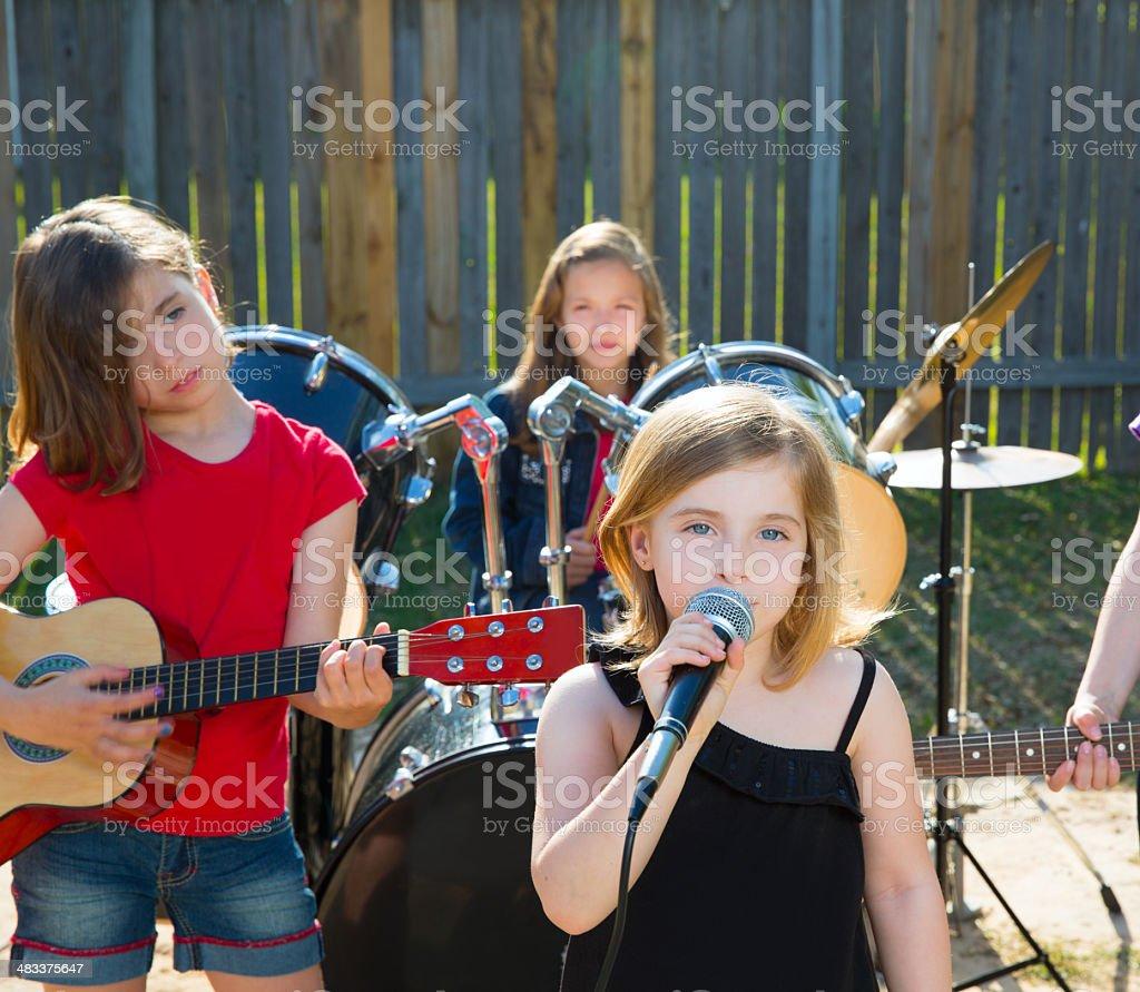 chidren singer girl singing playing live band in backyard royalty-free stock photo