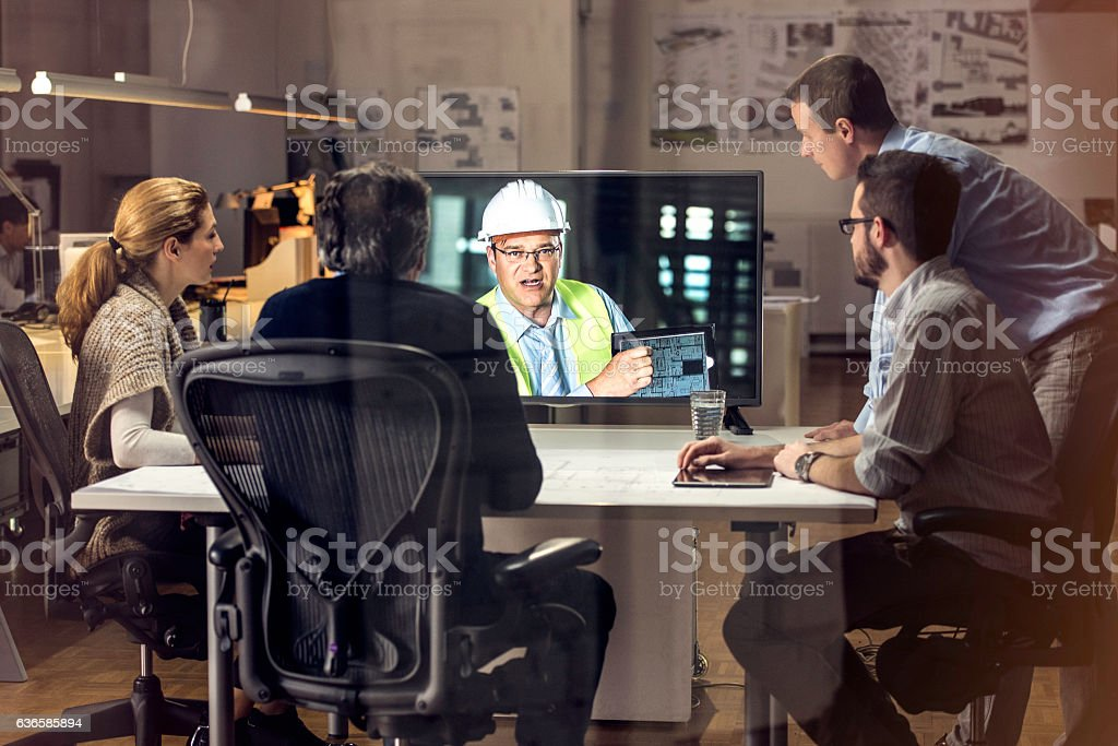 Chief construction engineer updating architects over video stock photo