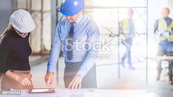 istock Chief constructor and female architect 637240144