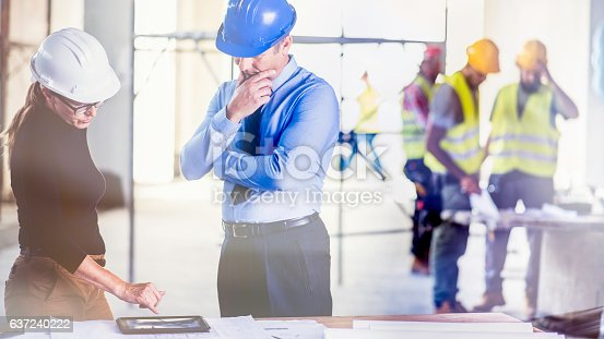 istock Chief constructor and female architect 637240222