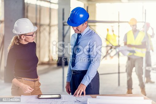 istock Chief constructor and female architect 637240394