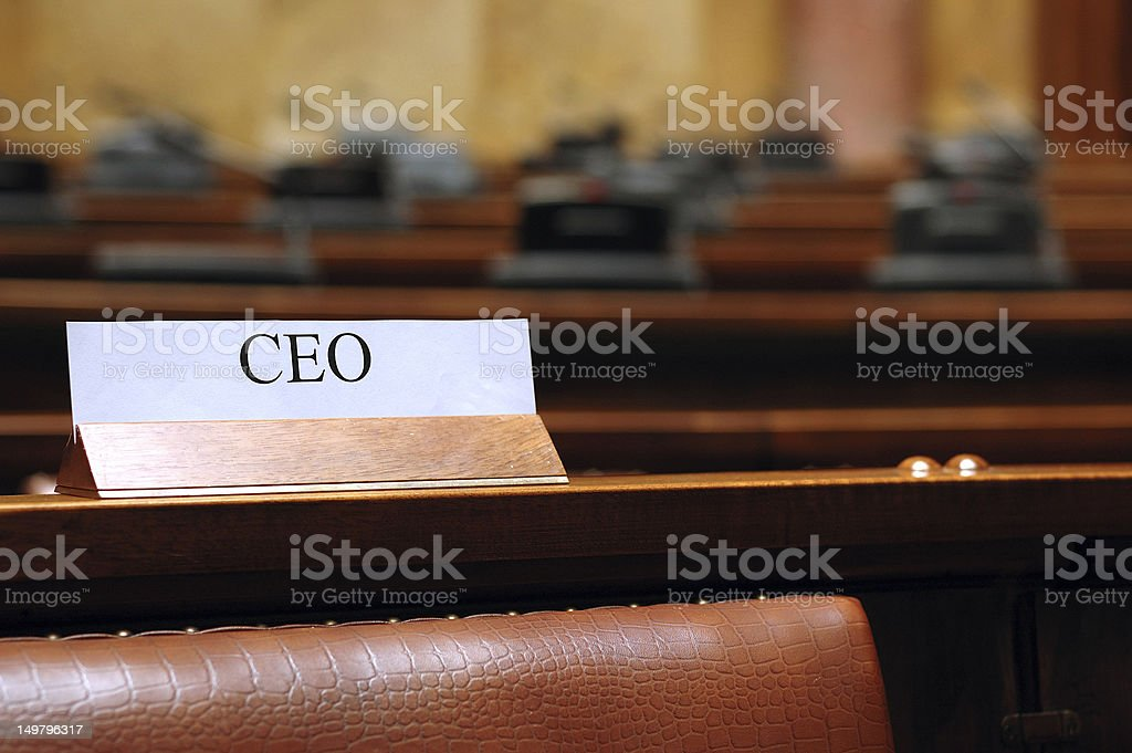 empty CEO seat in conference hall chief executive officer conference...
