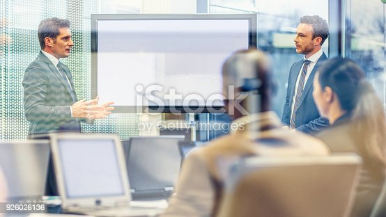 615617108 istock photo Chief executive talking to financial analyst at a meeting 926026136