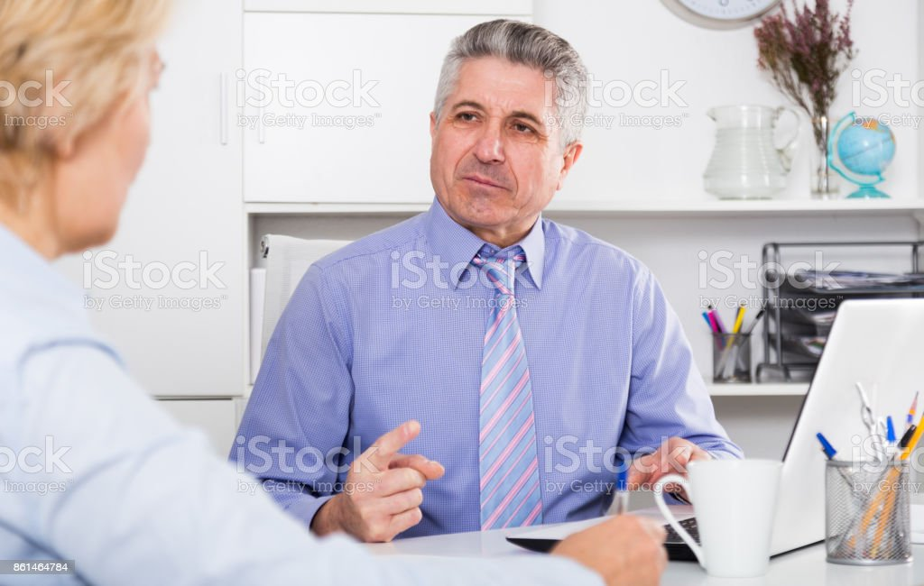 Chief gives task to assistant stock photo