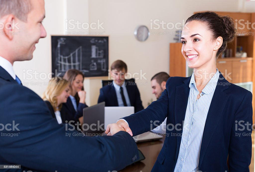 Chief greeting a member and celebrating stock photo