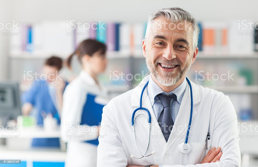 Chief physician posing in the office stock photo