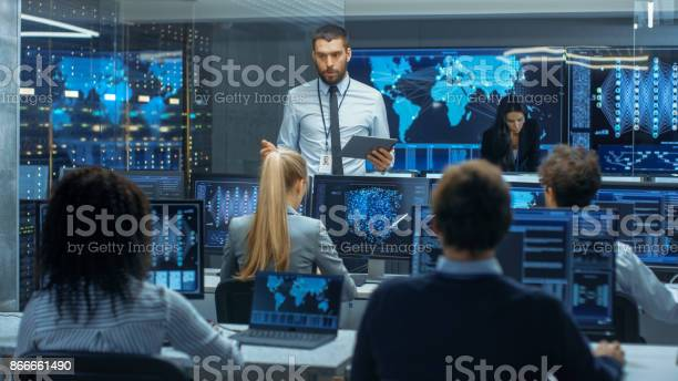 Chief Project Engineer Holds Briefing For A Team Of Scientists That Are Building Machine Learning System Displays Show Working Model Of Neural Network Stock Photo - Download Image Now