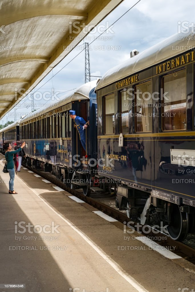 Chief wagon looking. The legendary Venice Simplon Orient Express is ready to depart from Ruse Railway station. stock photo