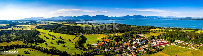 istock Chiemsee Lake Bavaria. Ising. Aerial Panorama Shot of Lake in Summer. Horse Stable. Agriculture Fields. Alps 1253602555