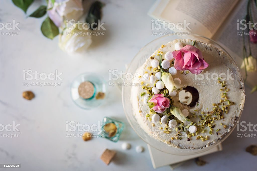 Chiffon cake with white chocolate glaze. Romantic mood stock photo