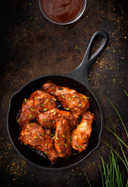 Chiken wings in a skillet stock photo