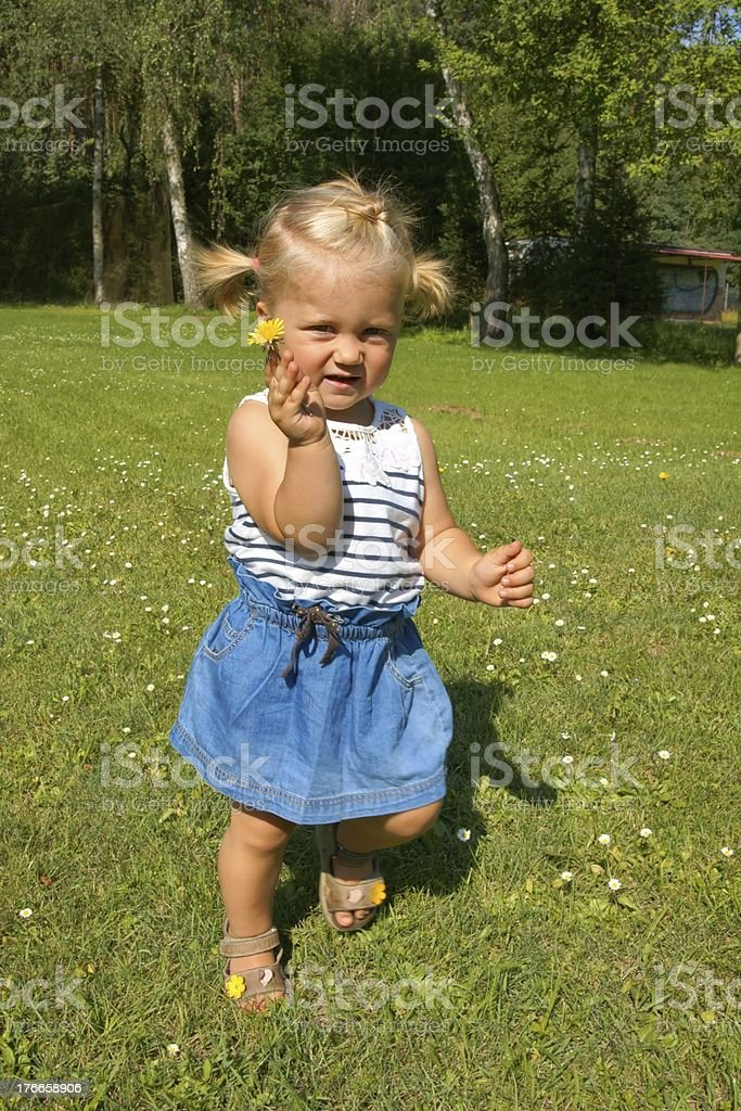 Child, a little girl having fun on the meadow royalty-free stock photo