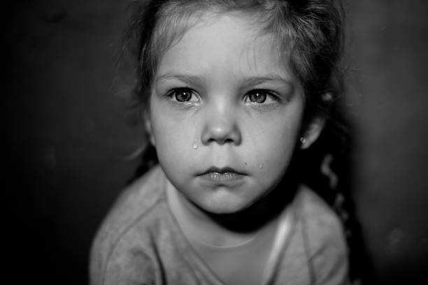 Child abuse at home stock photo