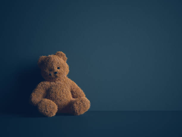 child abuse concept - teddy bear stock photos and pictures
