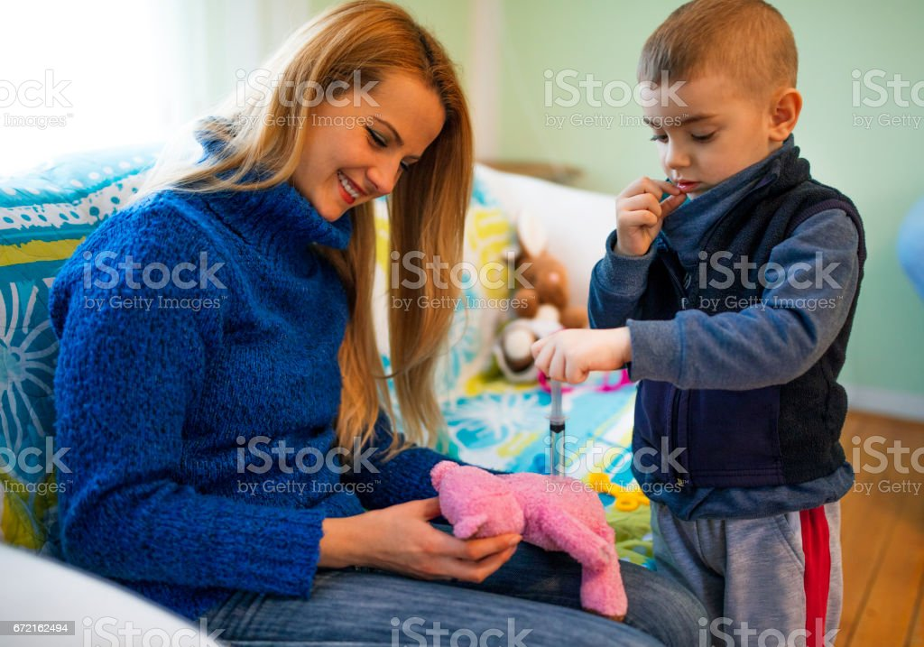Child acting doctor with stethoscope stock photo