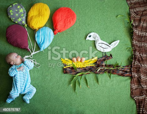 istock Child and a bird 492575787