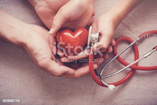 istock child and adult holding red heart with stethoscope, heart health,  health insurance concept 953685706