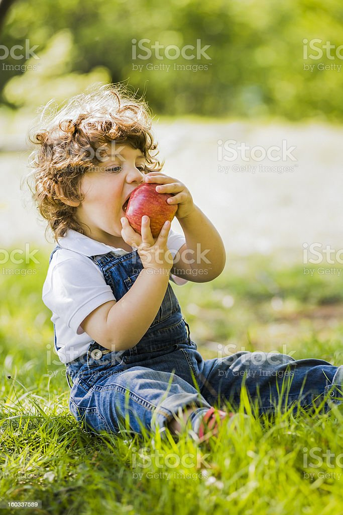 child and apple stock photo