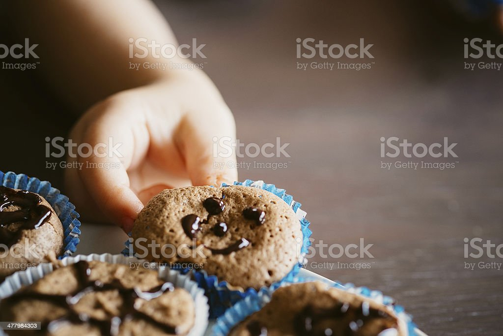 Child and cakes royalty-free stock photo