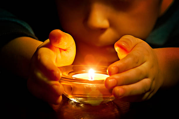 Child and candle light Child and candle light religious celebration stock pictures, royalty-free photos & images