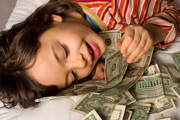child and dollars  allowance stock pictures, royalty-free photos & images