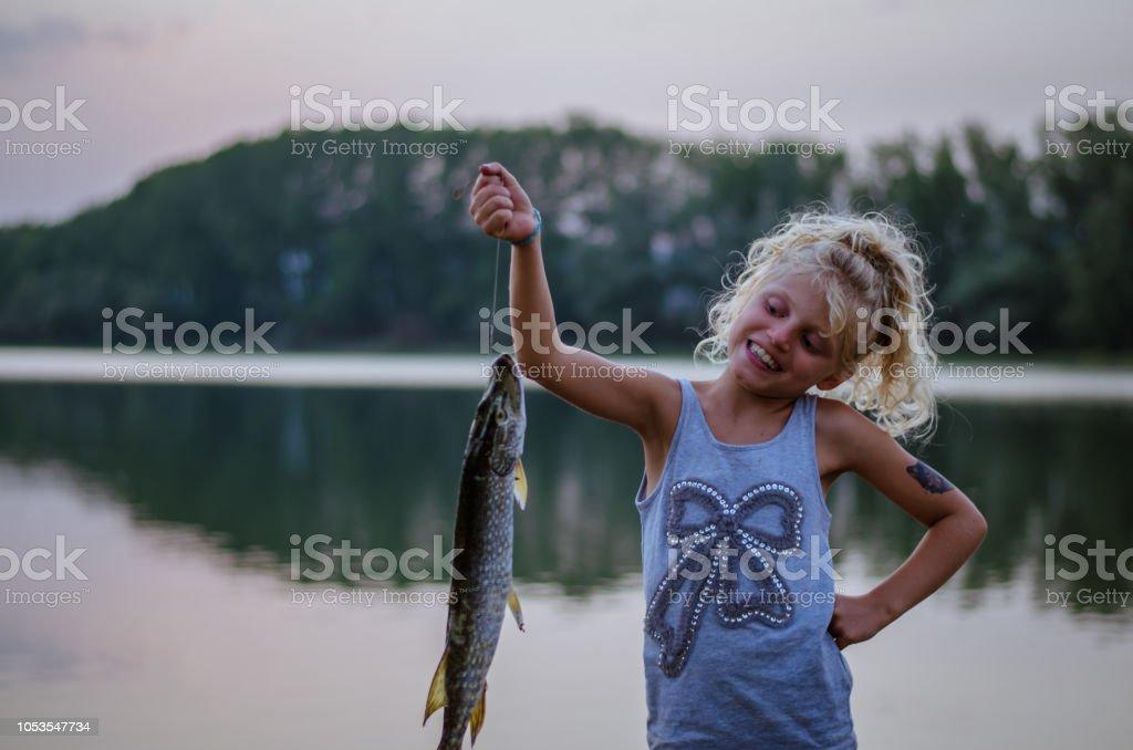 child and fish stock photo