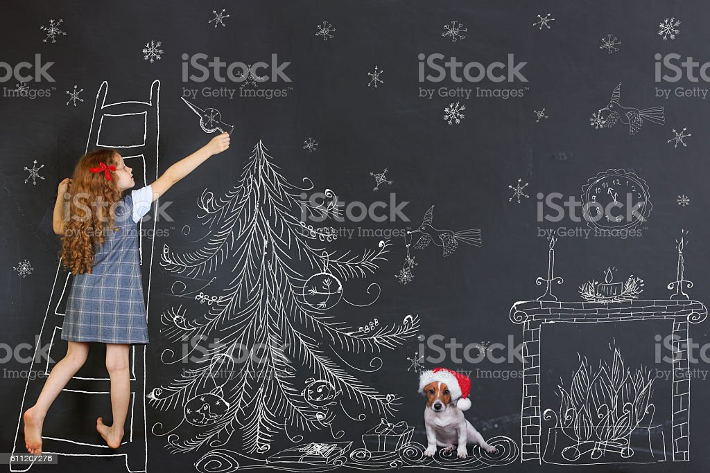 Child and her puppy decorates a Christmas tree stock photo