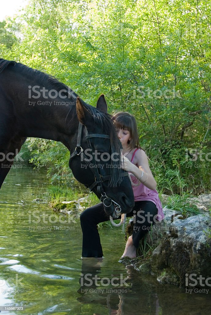 child and horse in river royalty-free stock photo