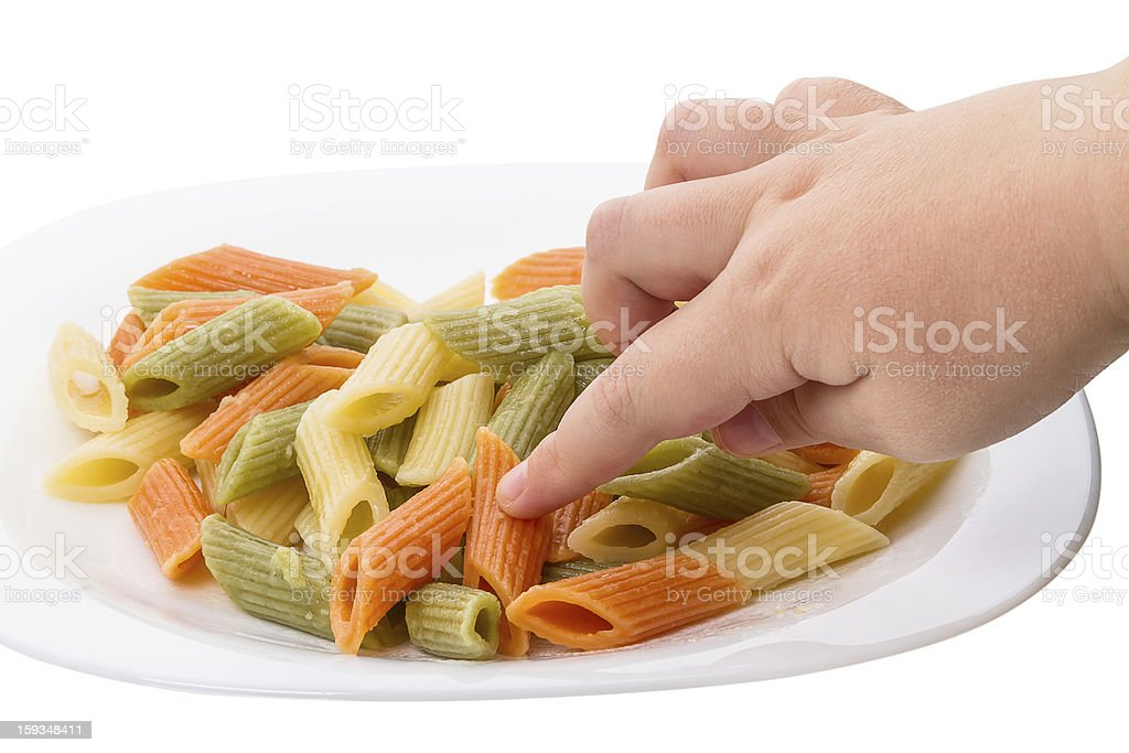 Child and penne pasta royalty-free stock photo