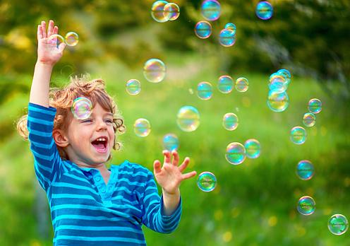 Child and Soap Bubbles