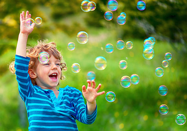 Child and Soap Bubbles stock photo