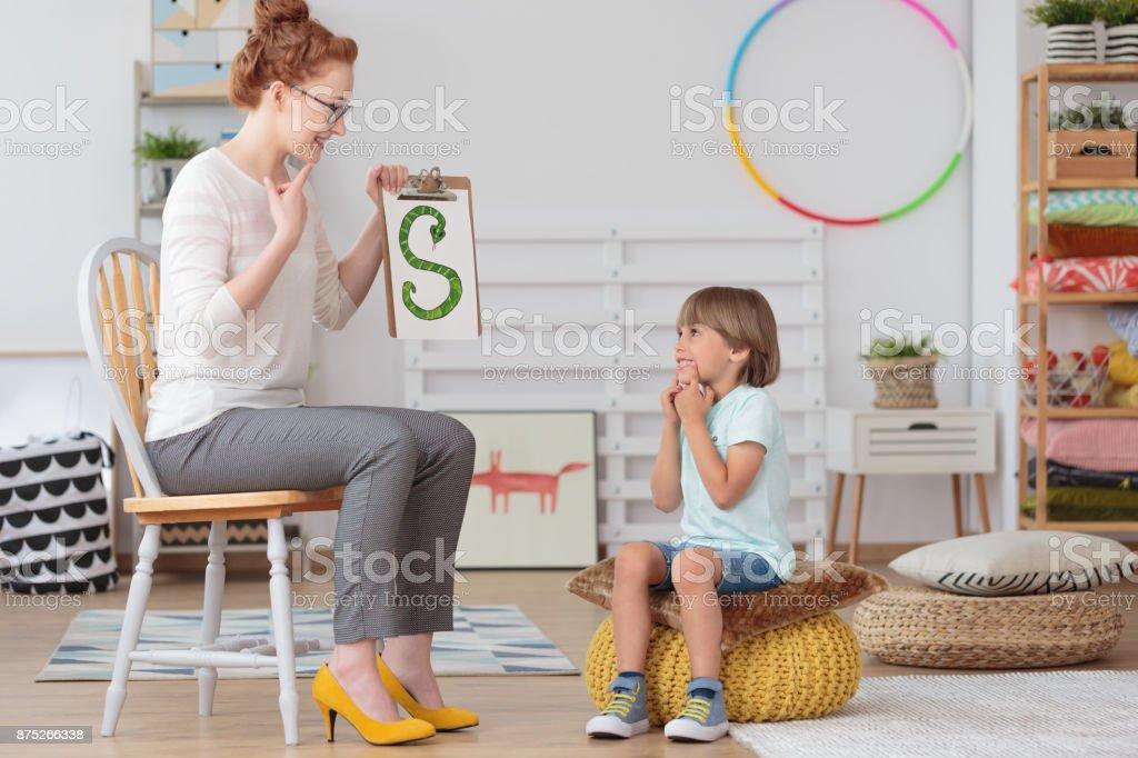 子供と幼稚園の先生 ストックフォト
