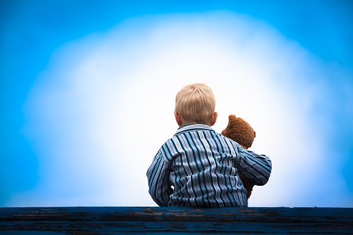 Child and Teddy at the Roof