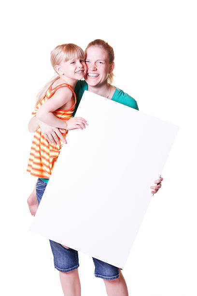 Child and Woman or Mother Holding Blank Cardboard Poster Sign stock photo