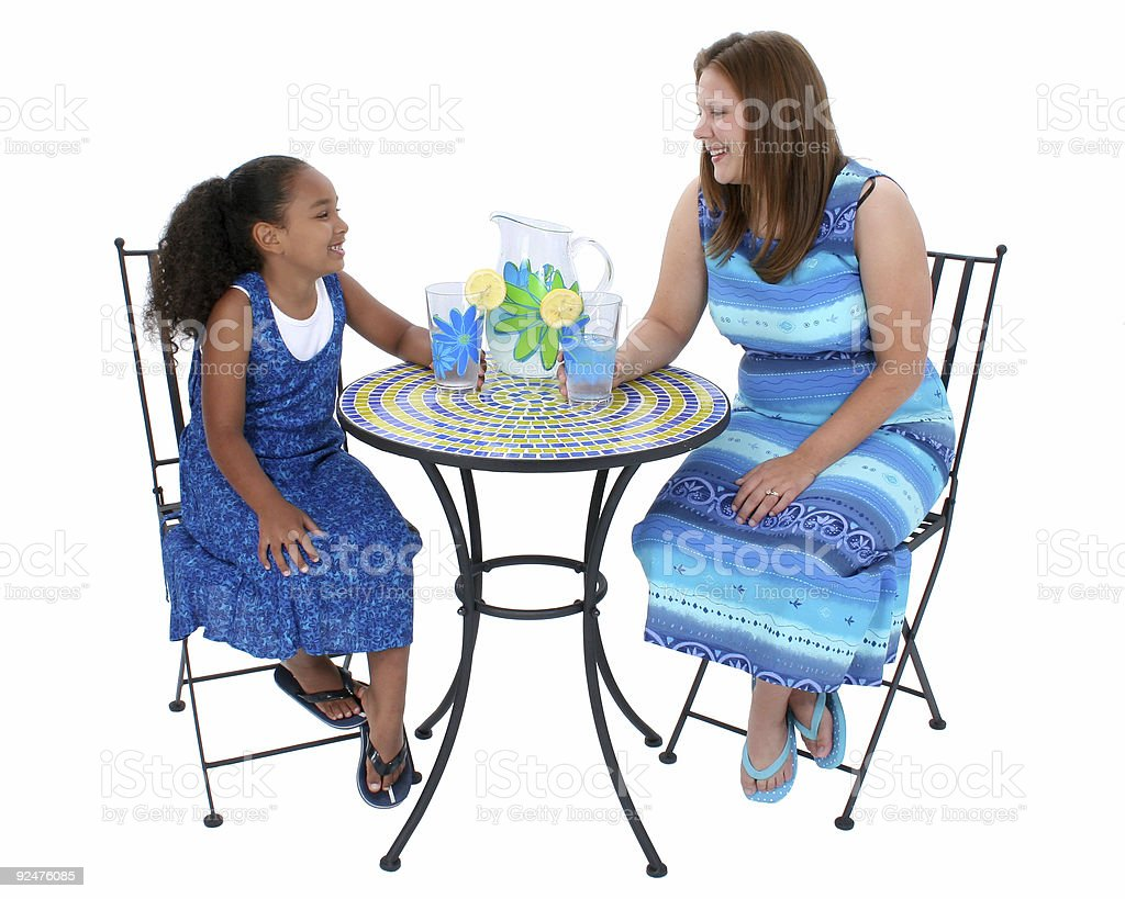 Child And Woman Sharing Lemonade At Bistro Table royalty-free stock photo