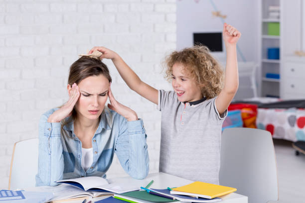 Child annoying his mother stock photo