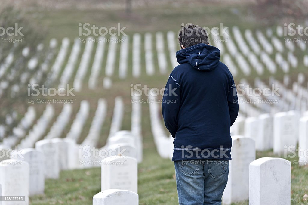 Child at a cemetery royalty-free stock photo