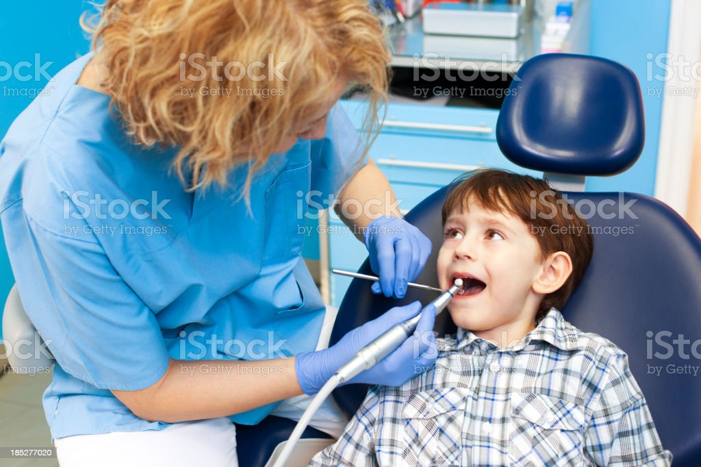 Child at dentist office royalty-free stock photo