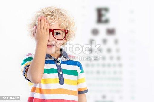 istock Child at eye sight test. Kid at optitian. Eyewear for kids. 861750006