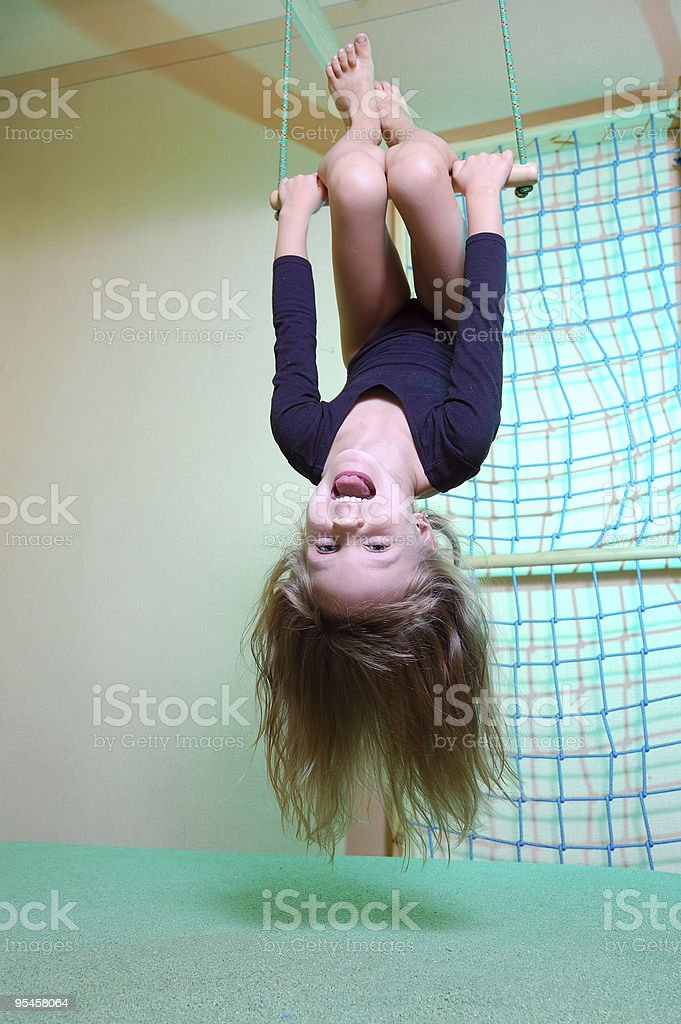 child at her home sports gym swinging royalty-free stock photo