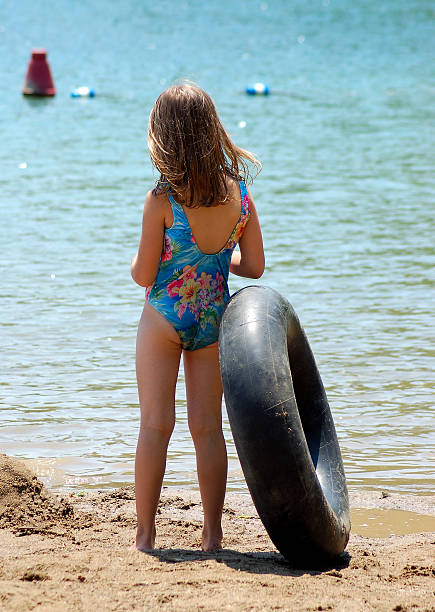 Child at the Beach with Floatation Device stock photo
