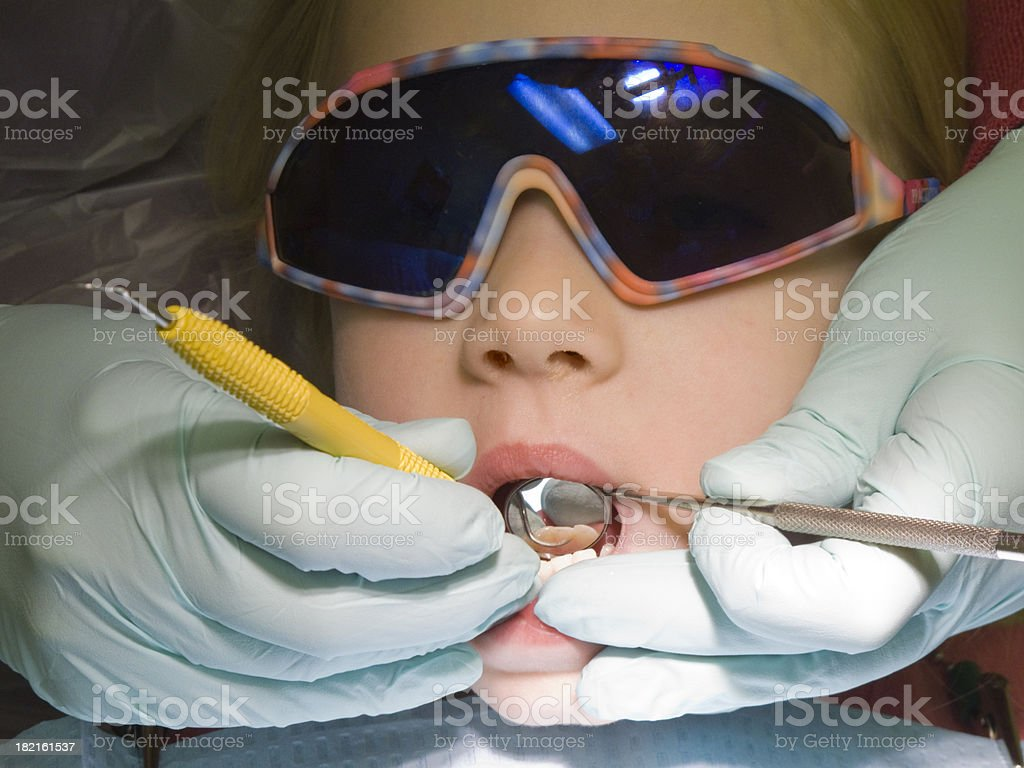 Child at the dentist stock photo