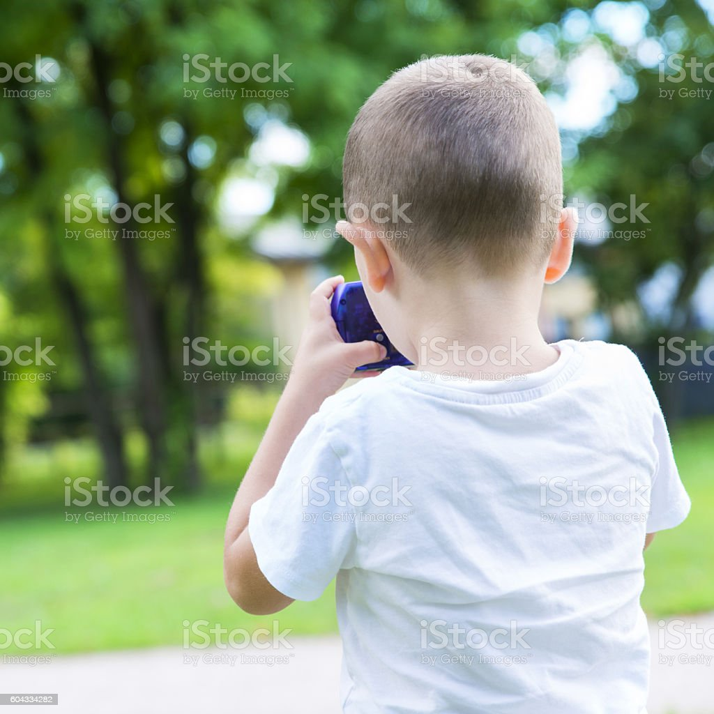 child at the park with the first camera stock photo