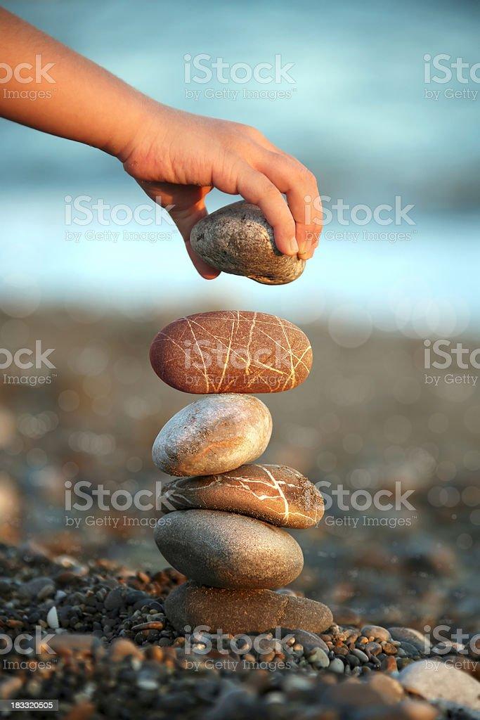 child balance stones royalty-free stock photo
