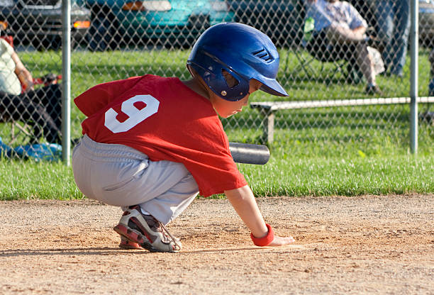 Child Baseball Player at Home Plate stock photo