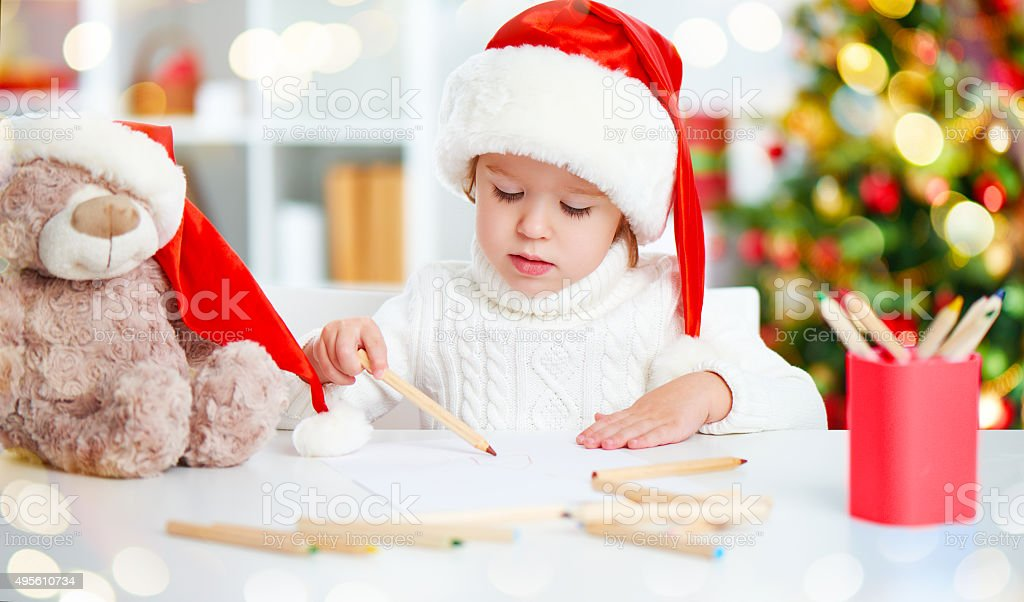 child before Christmas writes a letter to Santa stock photo